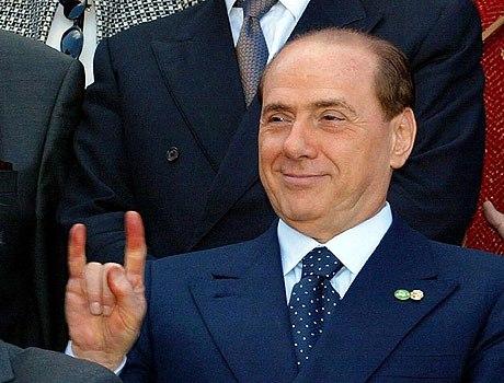 Berlusconi cuernos.