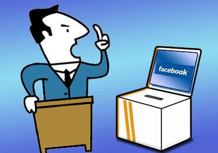 Atril hacia urna con Facebook.